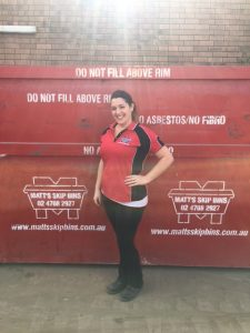 One of our lovely office ladies, Alisha infront of a 10 cubic metre bin