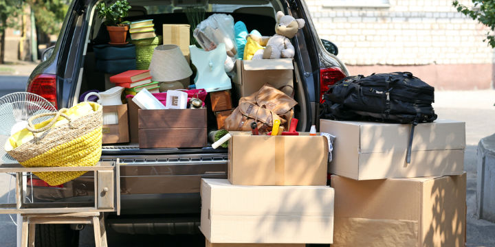 Car boot full of boxes and suitcases