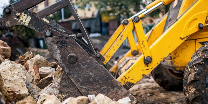 Bulldozer loading building waste to be removed and disposed of