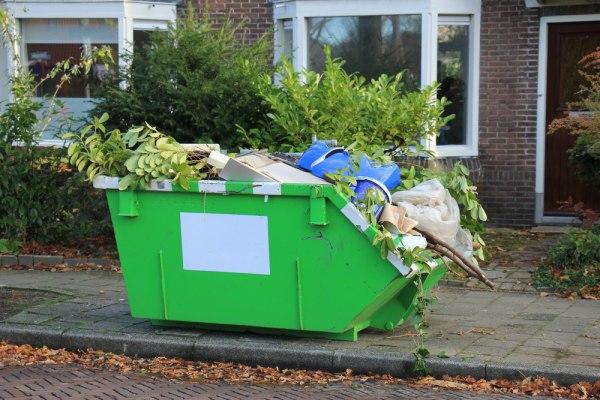 A loaded green skip bin